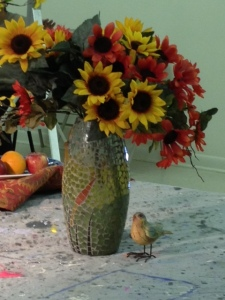 floral still life with bird